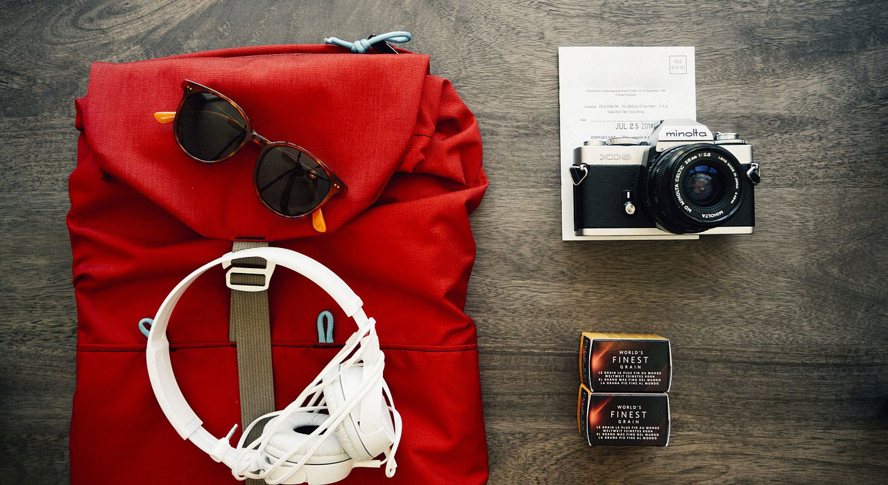 backpack, sun glasses and camera